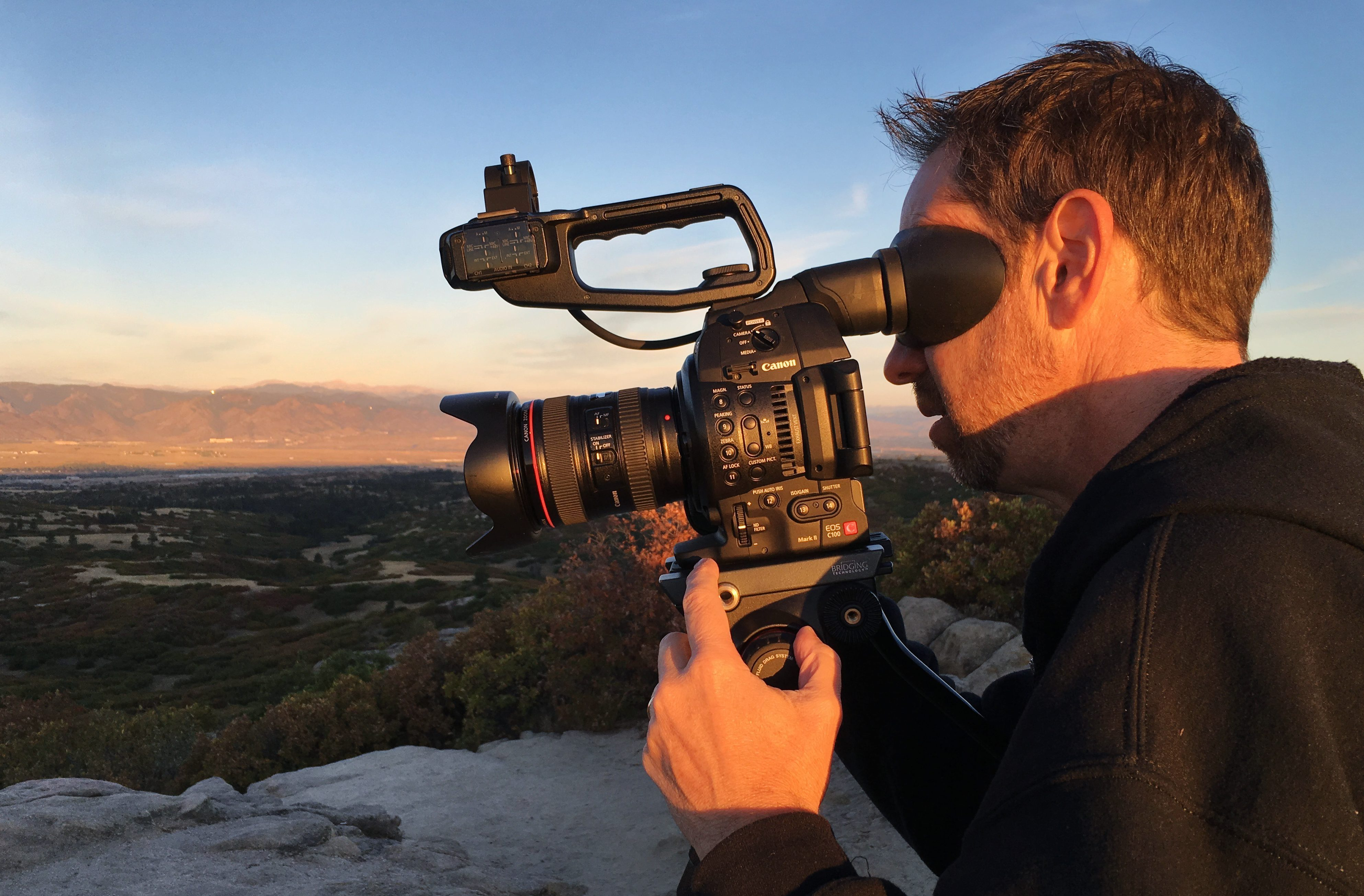 filming, camera, sunrise, sunshine, mountains, morning, evening, profile, viewfinder, lens, canon, c100, video, videographer, tell your story, visual legacy productions