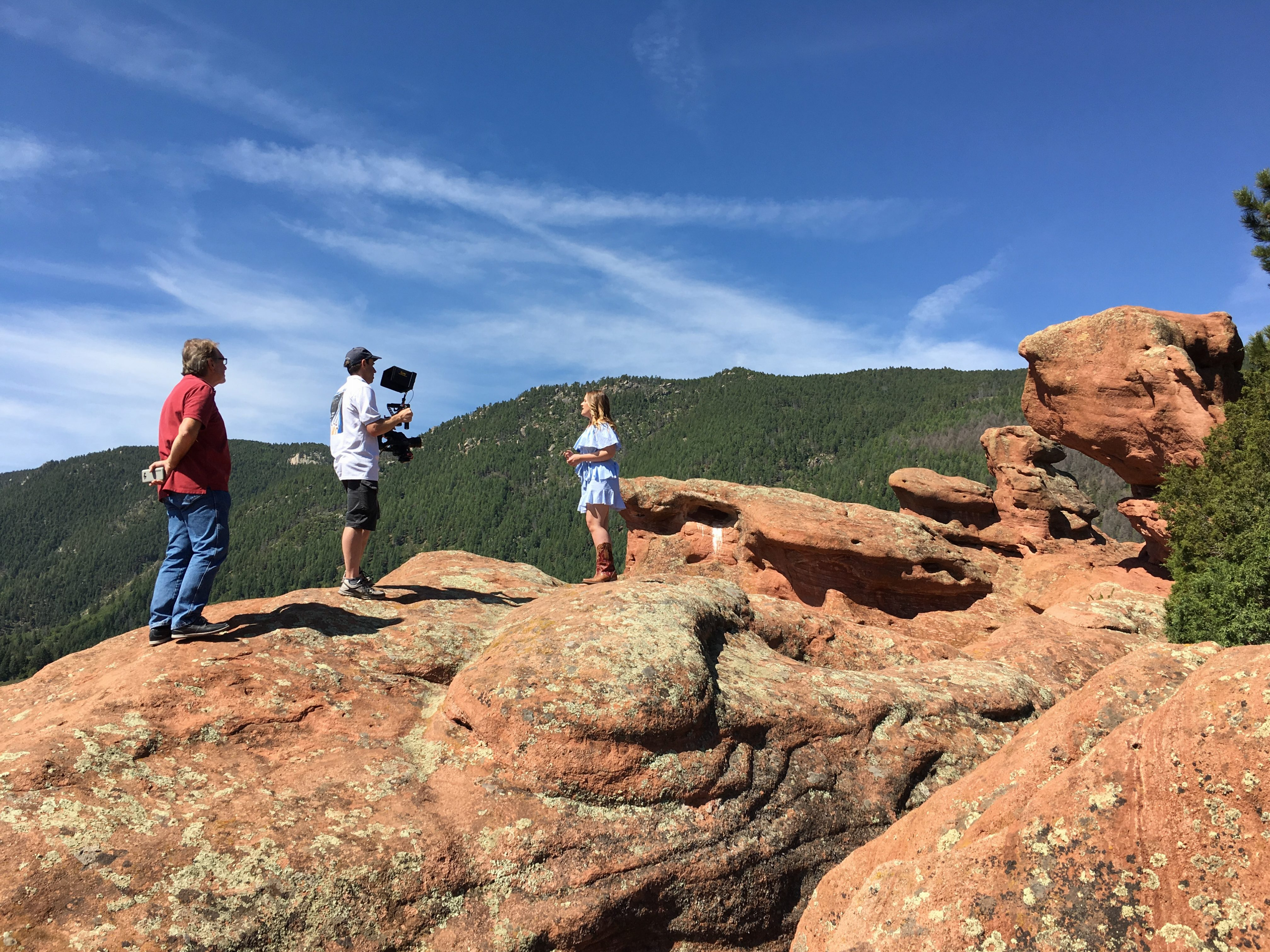 record, steady cam, red rocks, smile, sing, light, music video, background, mountains, filming, ronin, director, professional, quality, behind the scenes, camera, western, country, video, story, tell your story, Colorado, Taylor Rae, Visual Legacy Productions