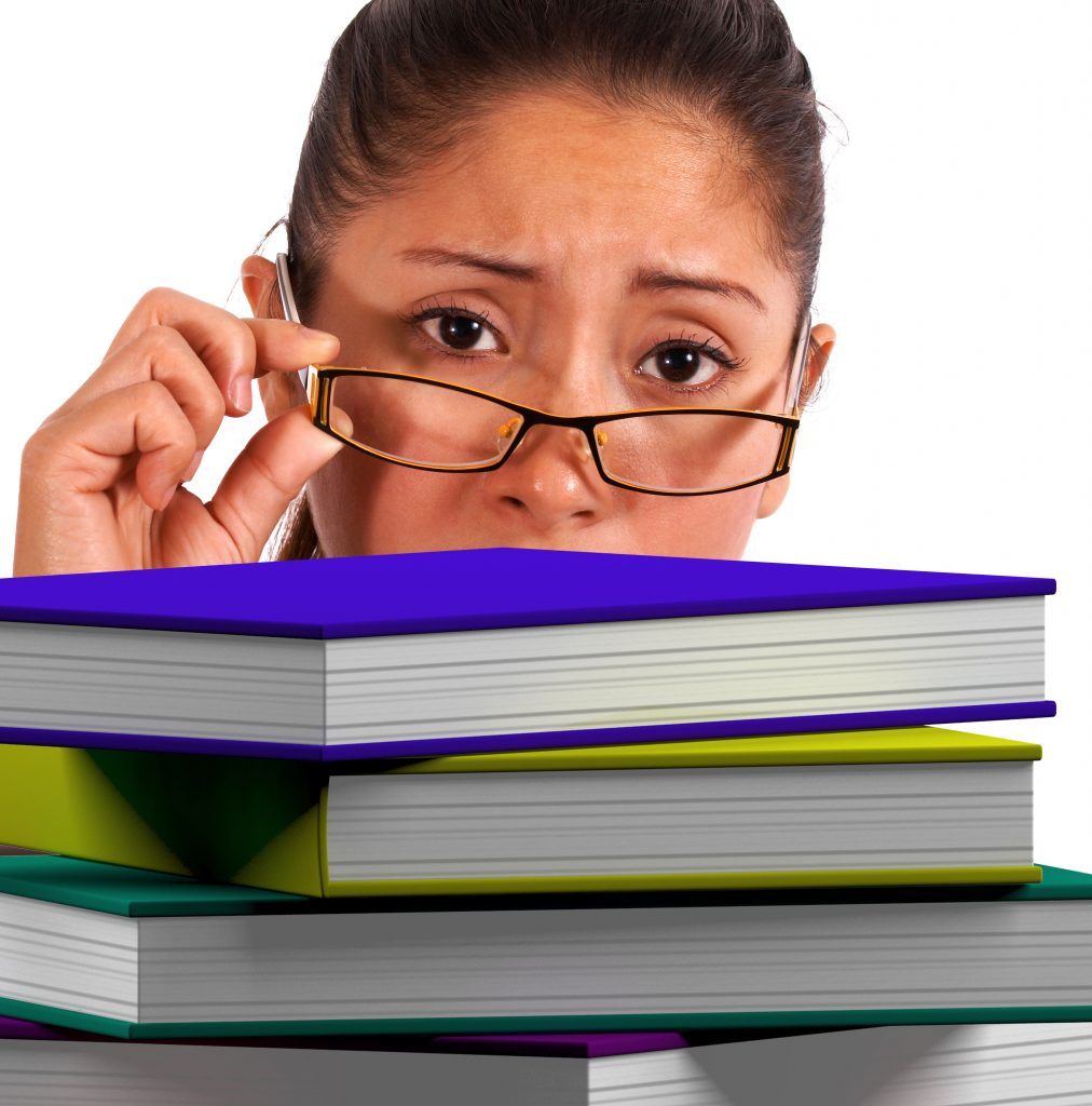 lady, woman, books, education, history, pile, overwhelm, tired, glasses, story, study, too much, visual legacy productions, video, production, tell your story, legacy